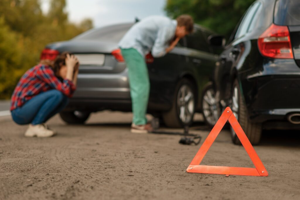 Car accident on road, male and female drivers