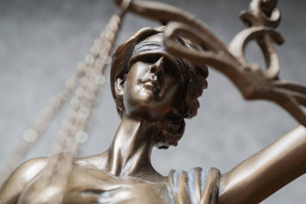 close-up of Lady Justice or Justitia statue as a symbol for law and legal topics
